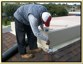 a roofer patching a roof where we fixed a roof